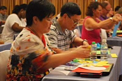 Missionaries express their emotions through art at the NCF Counseling and Member Care Seminar.