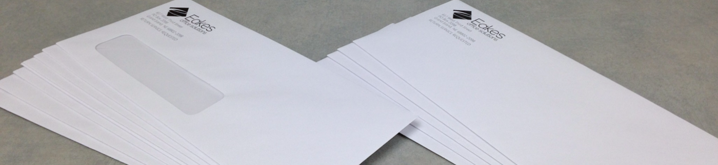 Custom Envelopes Laying on Table