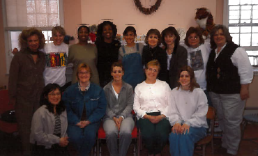 A Woman's Place staff in 1990.