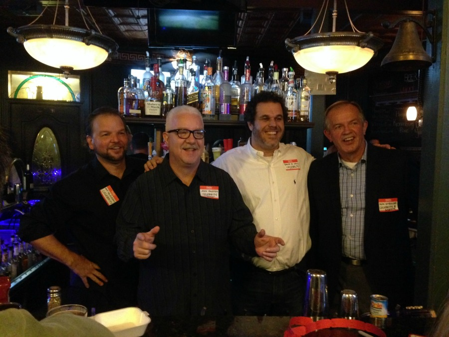 Local celebrities Pat McClosky, John Ralston, David M. Hall, and Mayor Ron Strouse bartend at Celebrity Bartender fundraiser event.