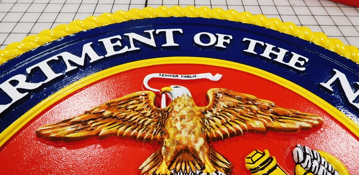 KP-1050 - Photo of Details of a Wall Plaque of the Marine Corps Seal; 3-D, Artist-Painted