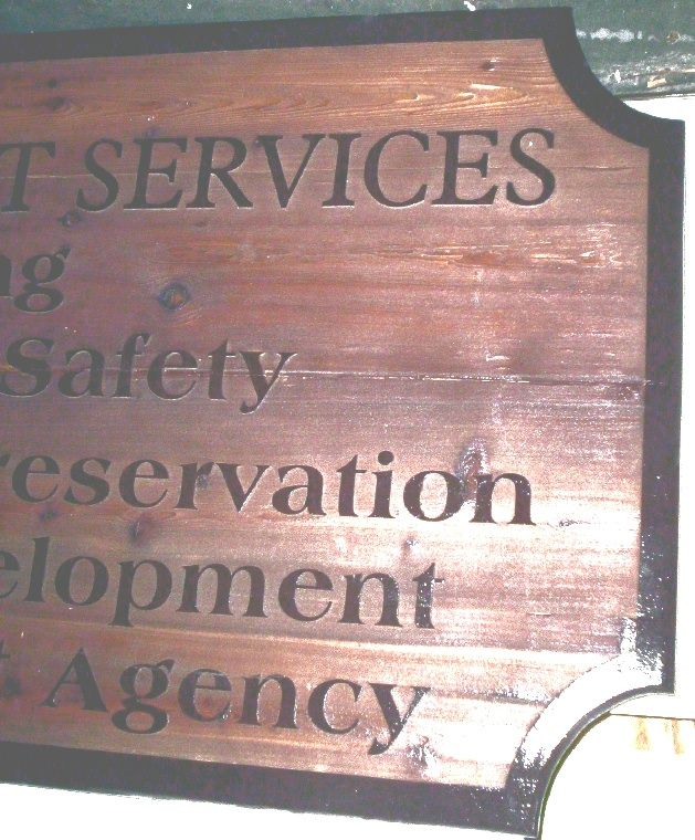 F15557 - Close-up of Carved, Cedar Wood Sign for Development Services    Preservation, Economic Development and Redevelopment Agency