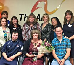 Board members, volunteers and staff celebrate Sara's achievements.