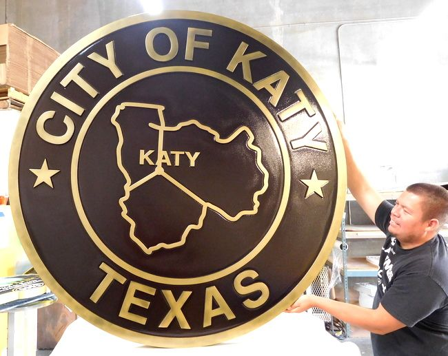 M7157  - PolishedBrass Wall Plaque for the Seal of the City of Katy, Texas