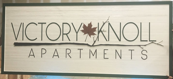 K20112 - Carved Western Red Cedar entrance sign for the Victory Knoll Apartments, with Maple Leaf as Artwork