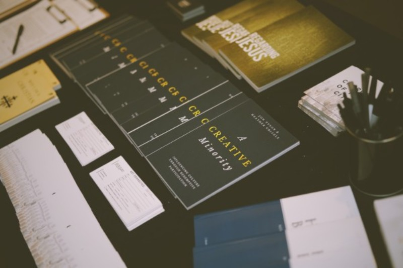 marketing brochures and business cards laid out on a table