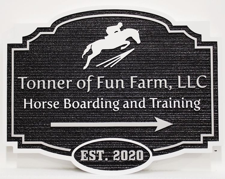 """P25321 - Carved and Sandblasted Wood Grain Sign for """"Tonner of Fun Farm"""", with a Jumping Horse and Rider as Artwork."""