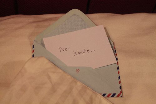"Photo of a note in an envelope that reads ""Dear Xanthe..."""