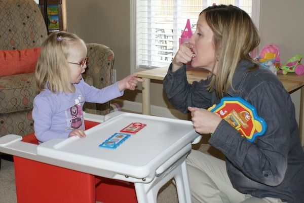 Toddler girl with Down syndrome at speech therapy.