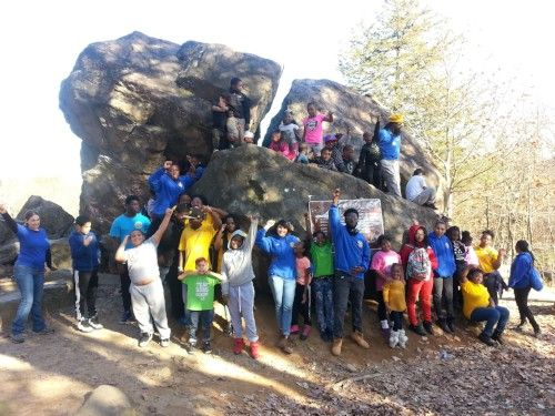 Solar Youth Interns and Stewards celebrate after a hike up to Judges' Cave in West Rock Ridge State Park