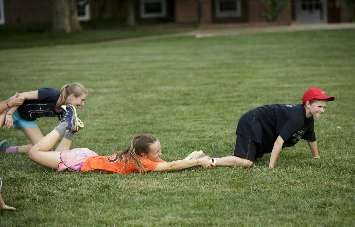 3 JYFs playing the game Wink on a grassy lawn