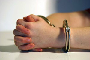 Juvenile's hands in handcuffs
