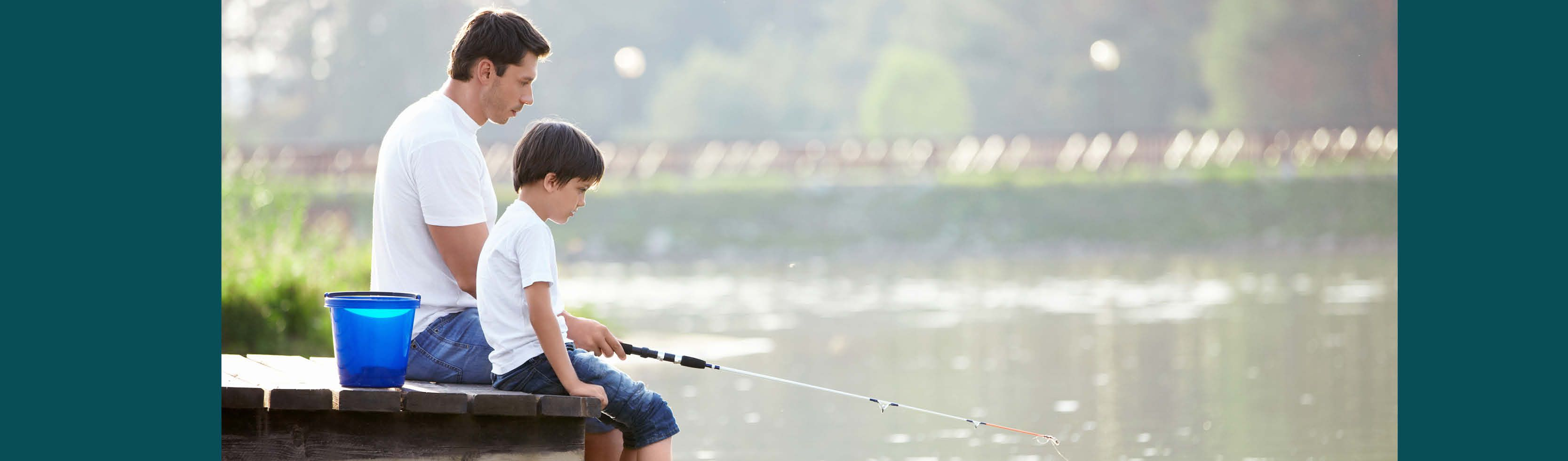father and son fishing. Parents are PMA members to protect their children