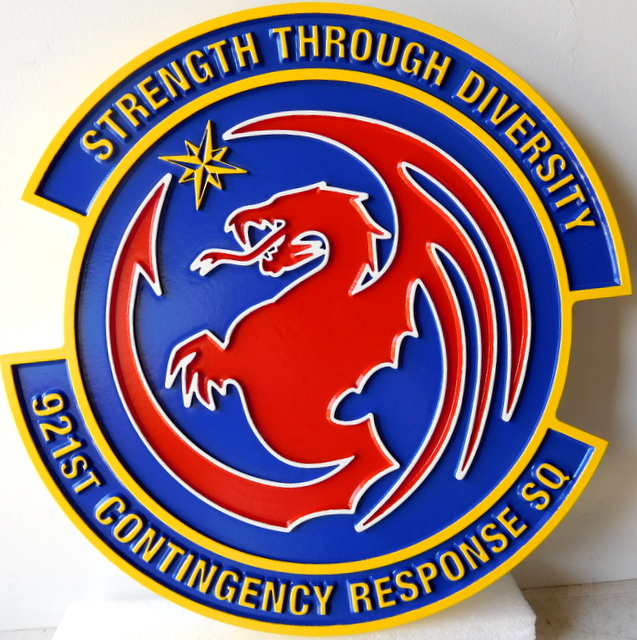"LP-3060 - Carved Round Plaque of the Crest of the 921st Contingency Squadron ""Strength through Diversity"""