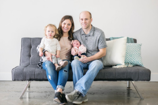 Cody with his wife, Alyssa, and their two daughters, Bentley and Indie