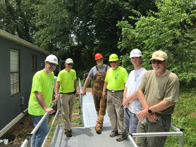 Group of men standing on a ramp.