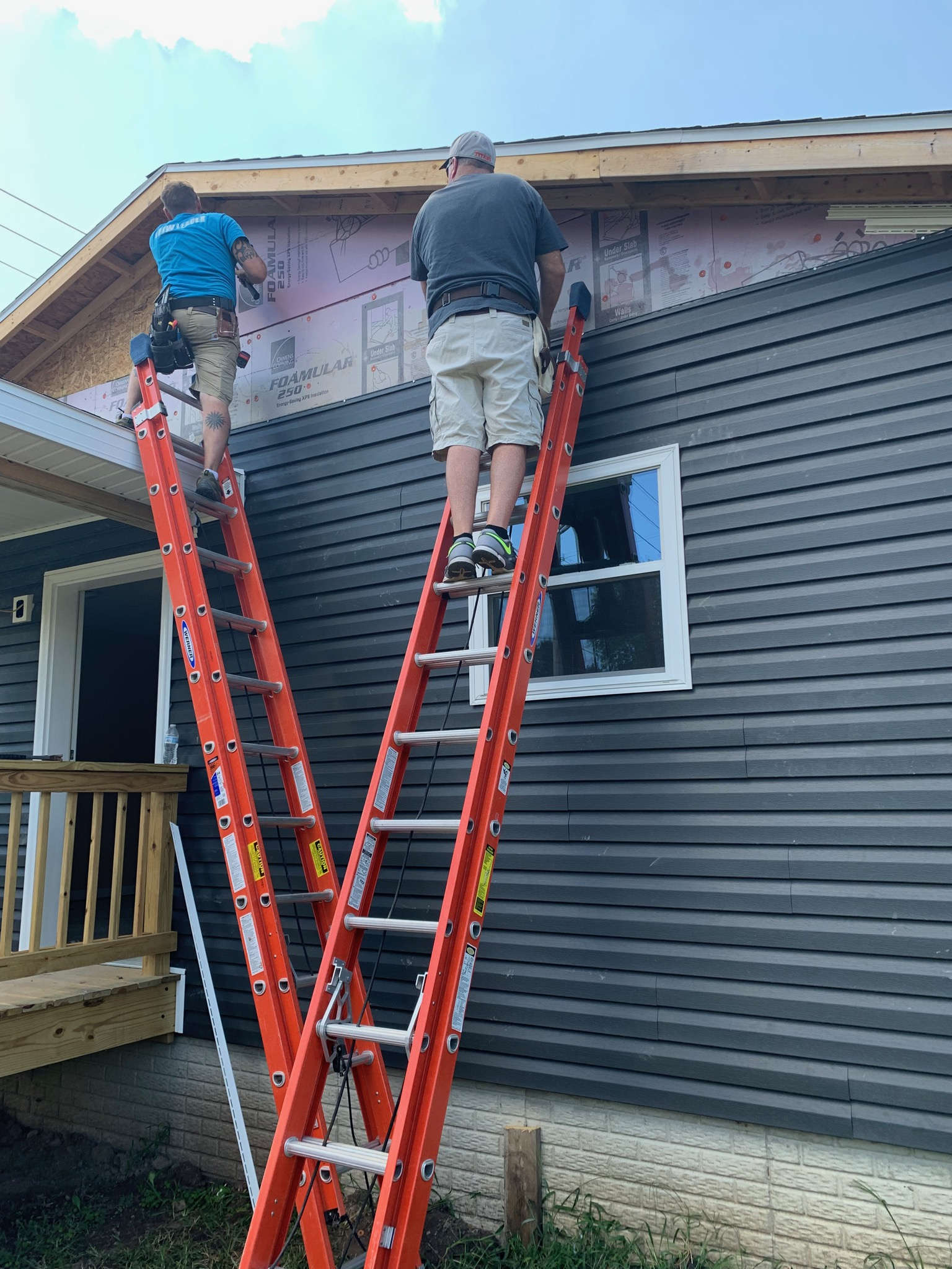 Siding being put up