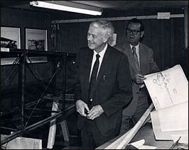 Charles Lindbergh and George Dade examining his Jenny