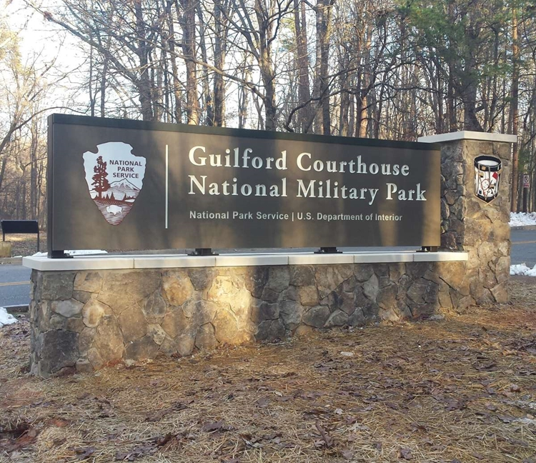 G16025 -  Entrance Sign for the  Guilford Courthouse National Military Park with Carved Colonial Drum