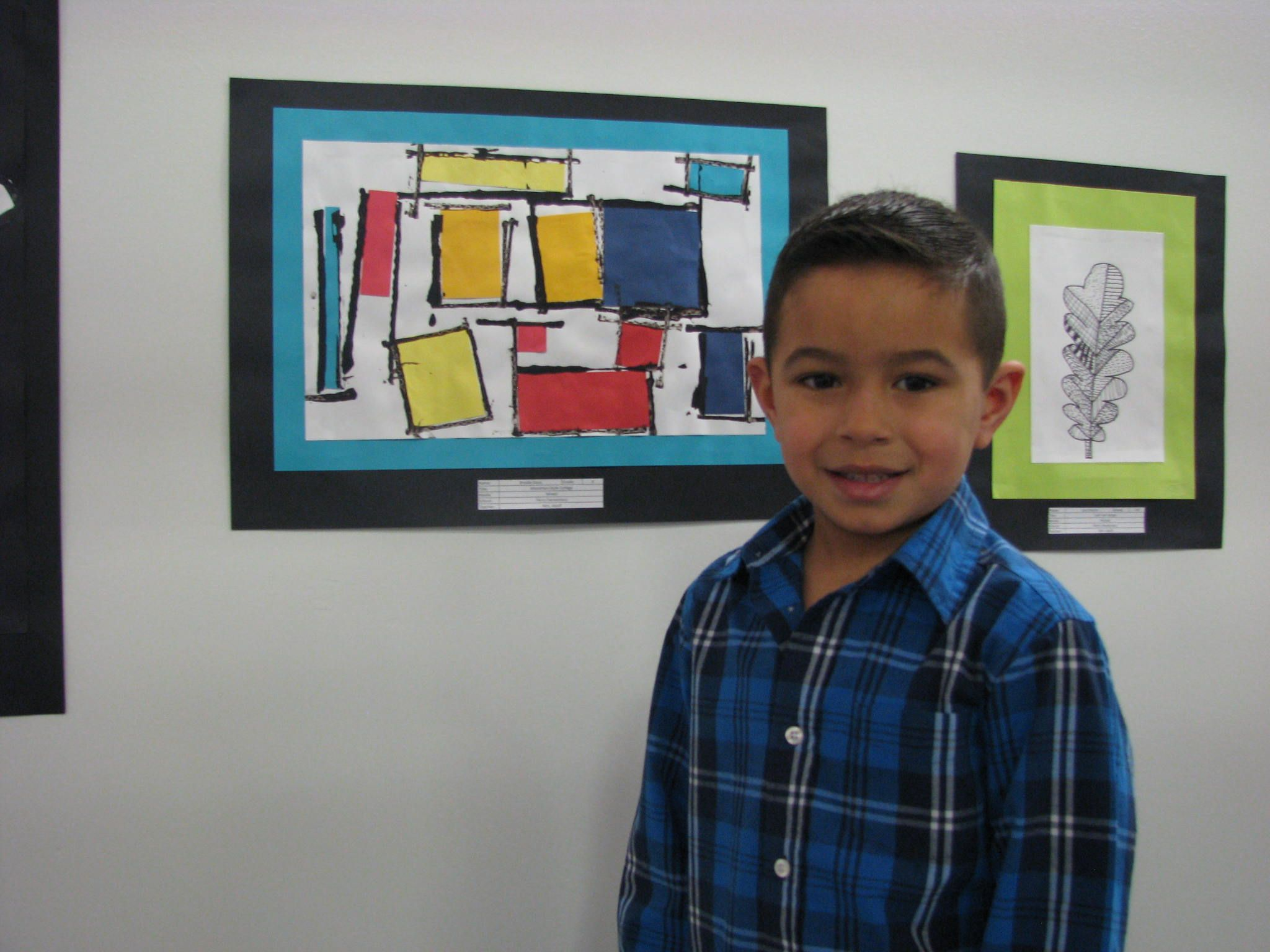 Young artist at the ACWC's K-8th grade exhibition reception