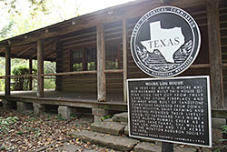 Edith Moore log cabin historical marker
