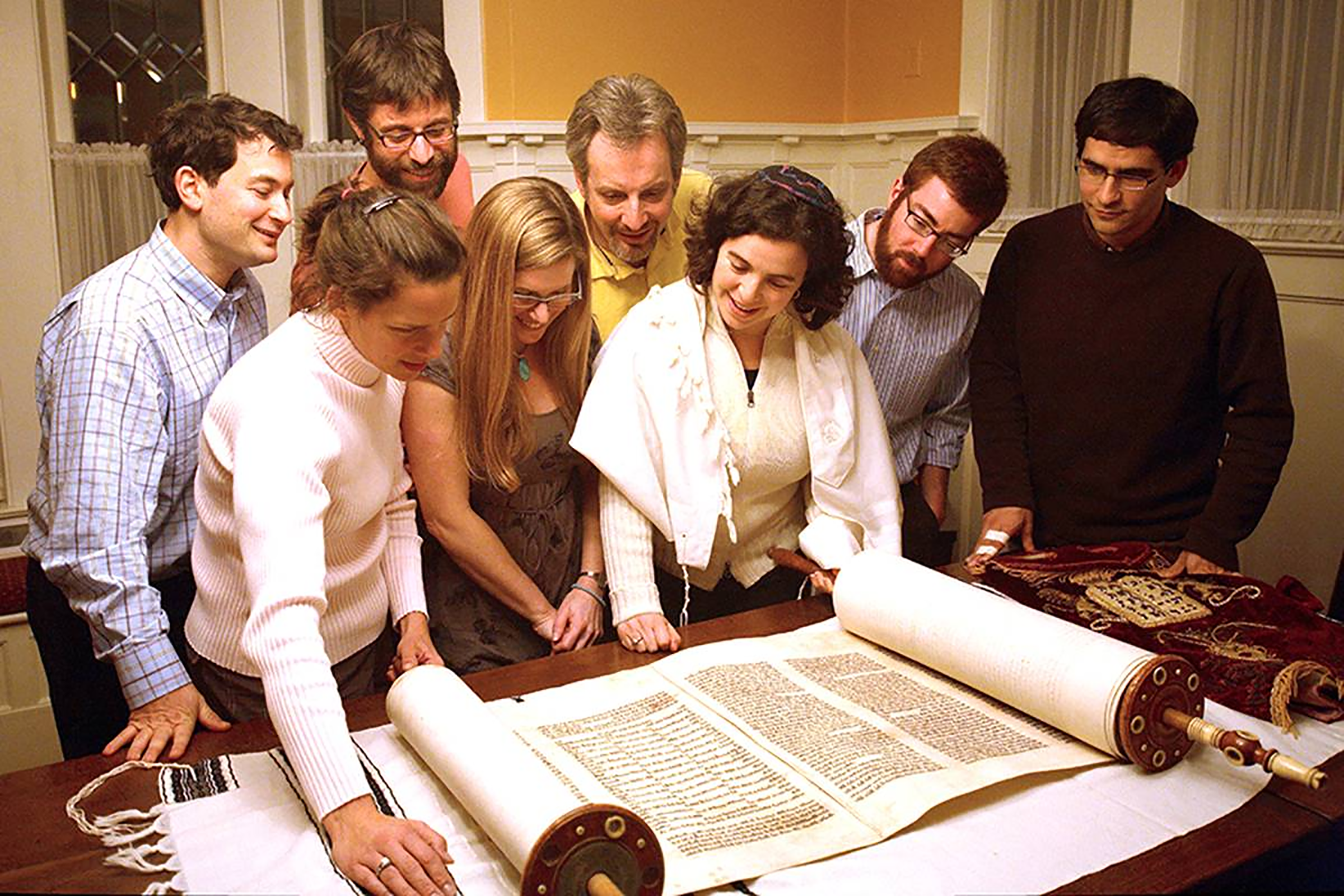 Rabbi Nussbaum and members of Kavana during the restoration of the Torah.