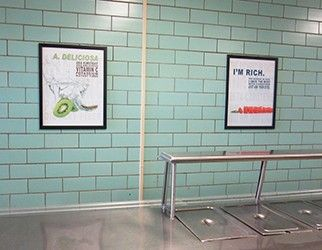 School café serving line with 2 food education posters on wall, white posters with nutrition facts