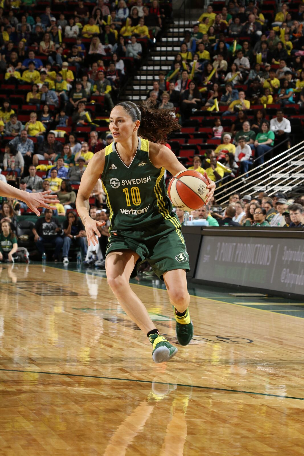 Sue playing with Seattle Storm.