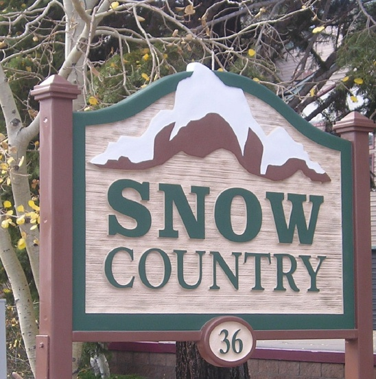 M22002 - Condominium Entrance Sign with Snow-Capped Mountain