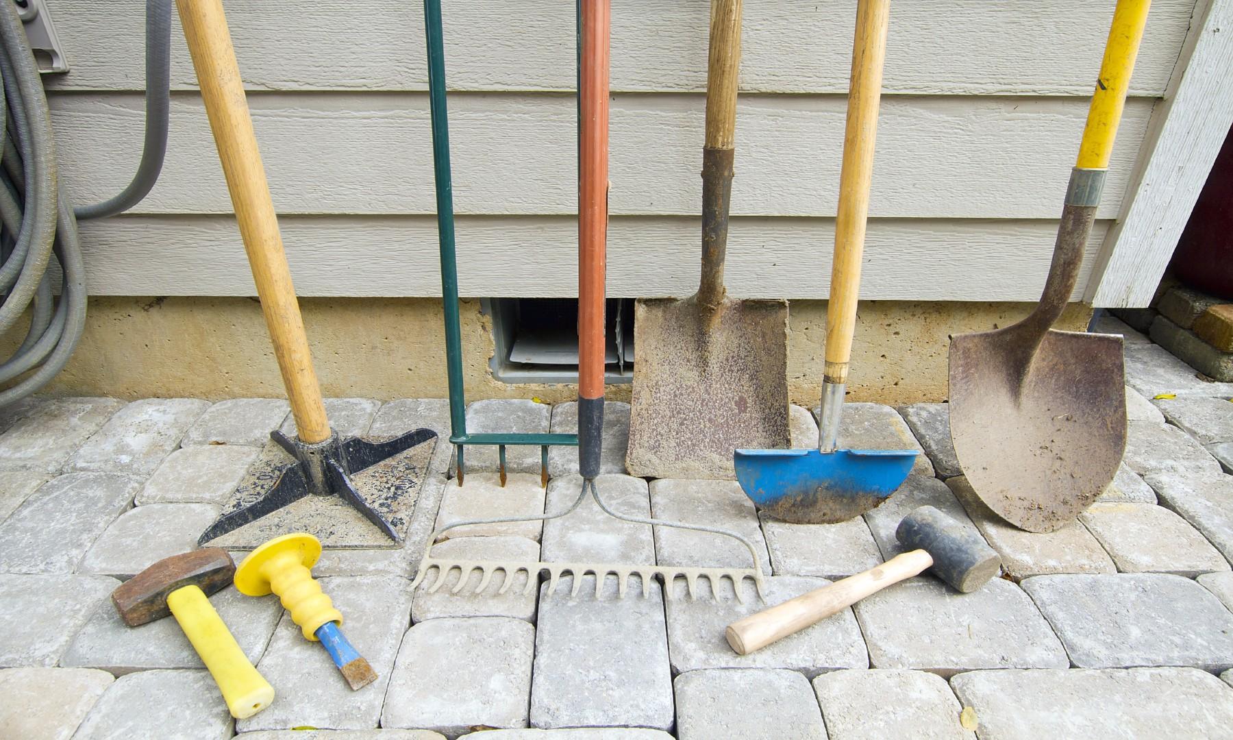rakes shovels and assorted yard tools