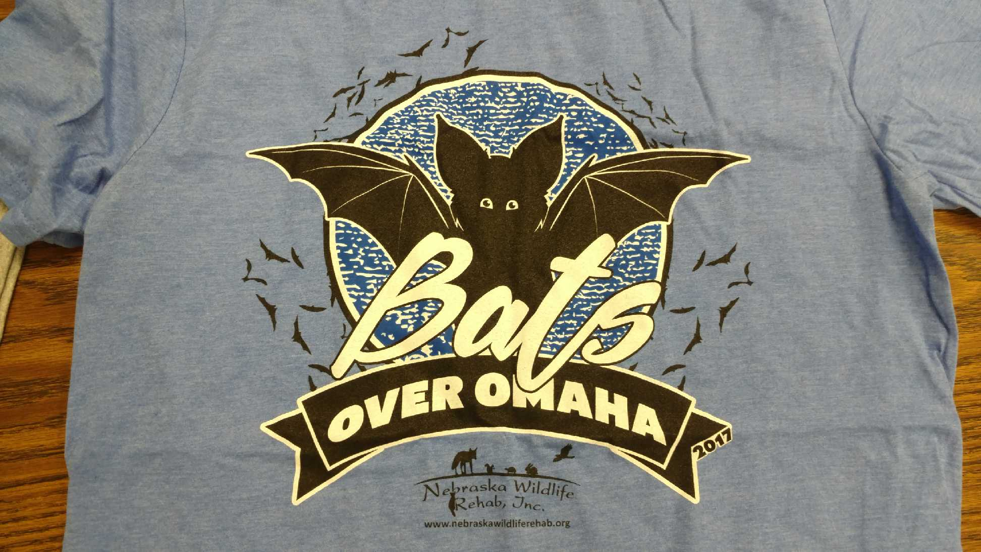 Bats Over Omaha Bat Release T-Shirt - 2017: Adult Small, Heather Blue