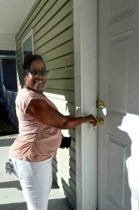 Two families celebrate new Habitat homes