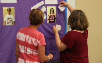 Student adds things to her self-advocacy profile on sticky wall