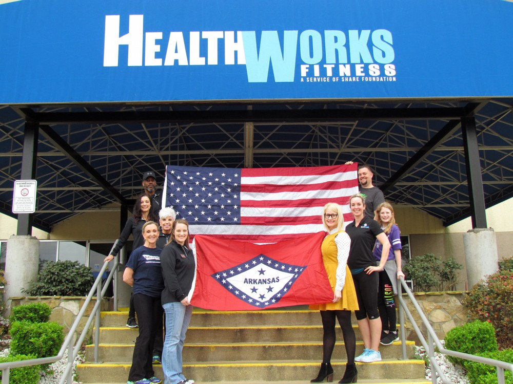 WoodmenLife presents flags to HealthWorks