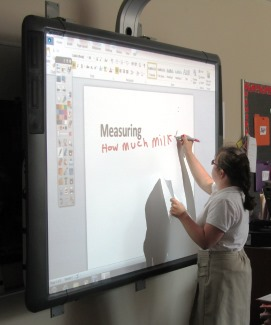 Student writing on Promethean Board