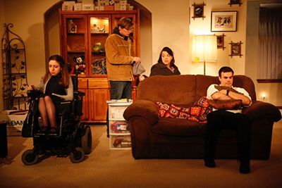 THE HEALING - 2016. (L to R) Shannon DeVido, John McGinty, Jamie Petrone and David Harrell. A group of friends who are dress formally in a living room.