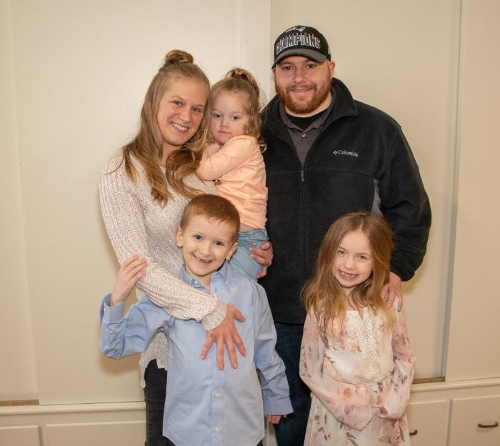 USMC Veteran Jennifer Delph holds 2 year old daughter Madison, Timothy Lawrence, kids John Walsh jr. and Alexandra Reimels
