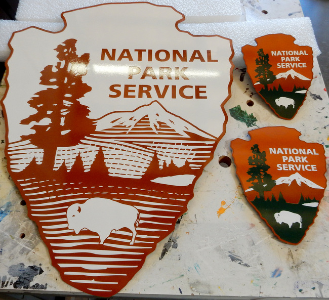"G16067 - Photo Illustrating Painted and Outline (Unpainted) National Park Service ""Arrow"" Emblems"