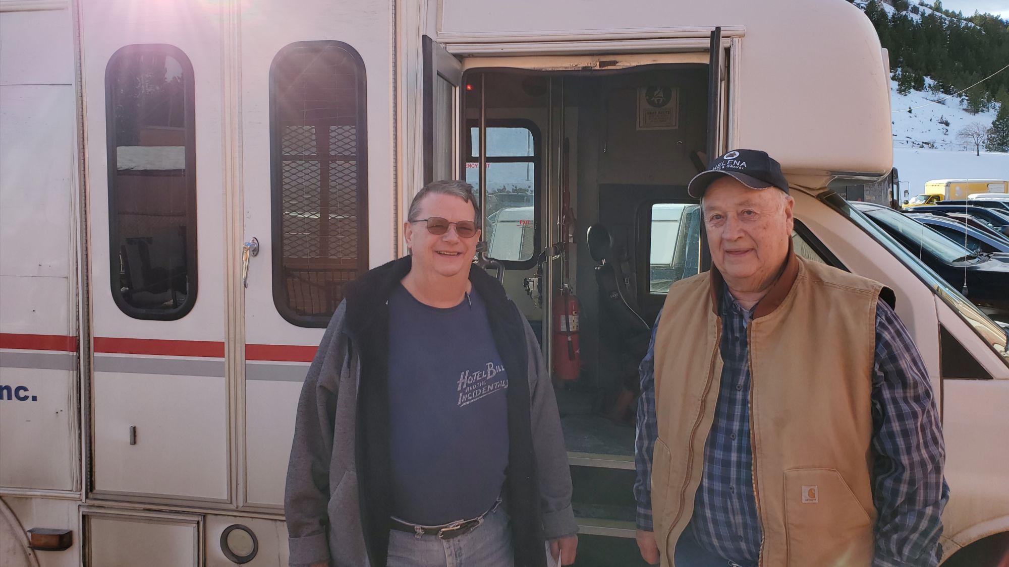 Pictured: Rocky's two bus drivers in front of the RMDC Senior Bus.