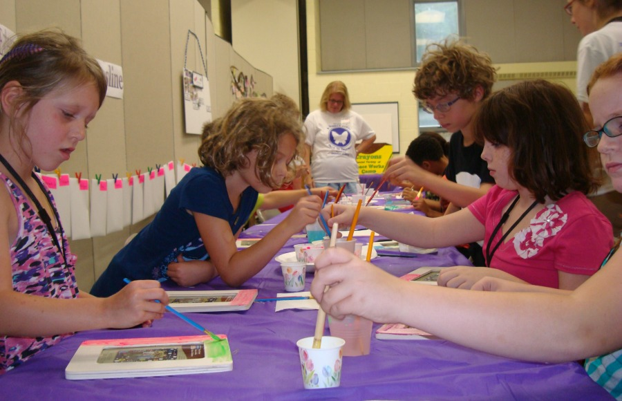 Painting picture frames for healthy relationships at AWP's Peace Works Camp.