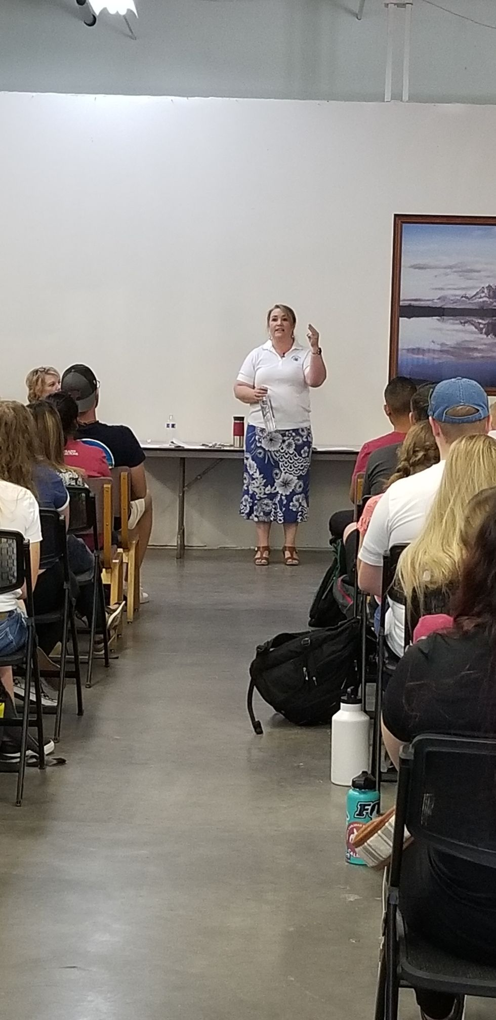 Shirlee Draper presenting to DSU student volunteers in polygamist community