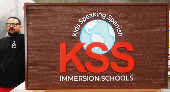 "FA15710 - Carved  and Sandblasted Wood Grain HDU Entrance Sign for the ""KSS Immersion Schools"", with Globe Logo as Artwork"