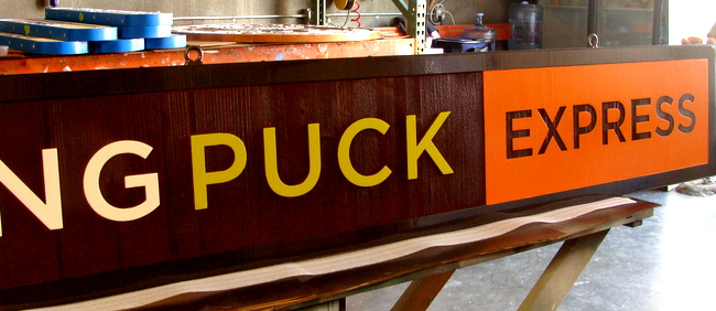 Q25010 - Close-Up of Wolfgang Puck Express Restaurant Sign
