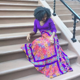 Instagrammer @patricejwill sitting on a staircase wearing a thrifted outfit