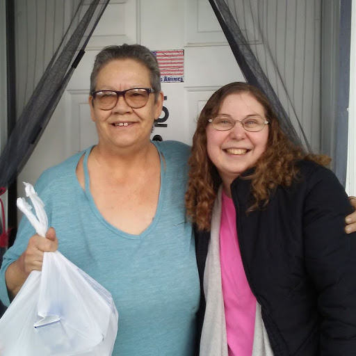 Kayla (right) delivers senior  meals in Omak & Okanogan