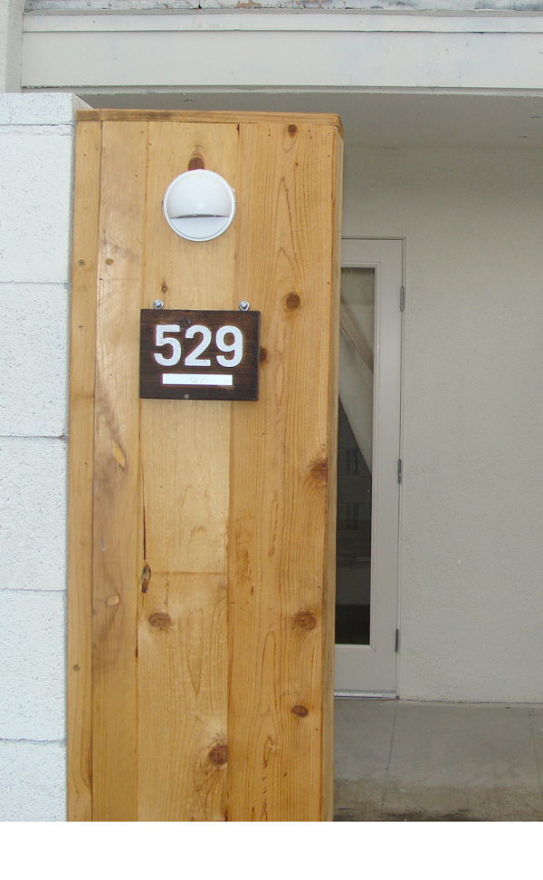 T29193 - Rustic  Redwood Room Number Plaques Mounted on wall