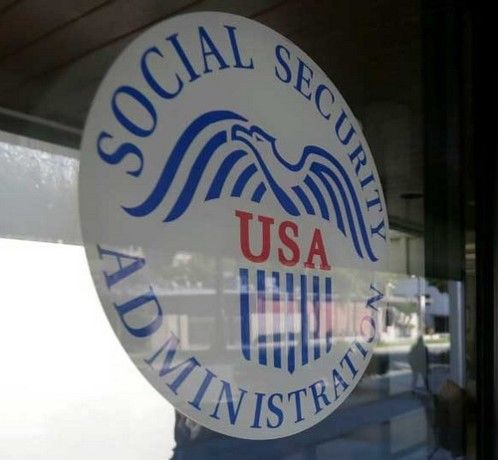 large social security logo sign in a the window of an office