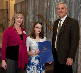 Sen. Paul Bussman presents a Senate Proclamation to Rachel Vance and her teacher Susan Boyd