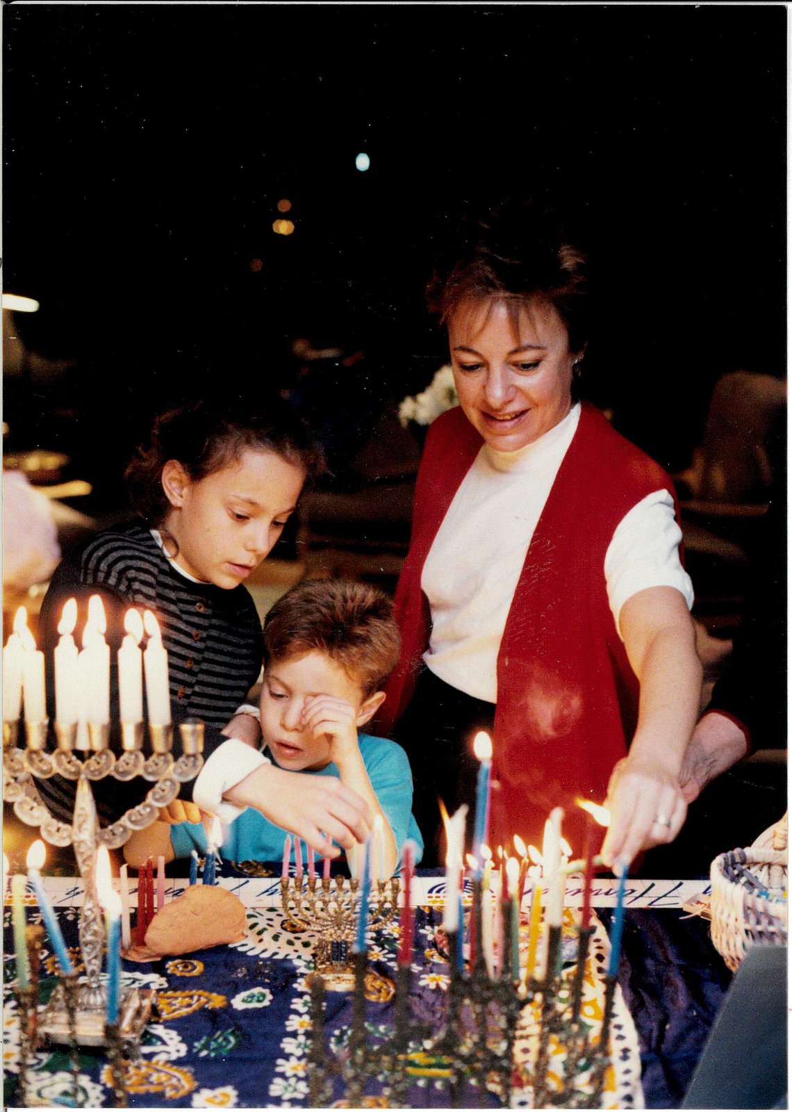 Michele and two of her three children, Mimi and Jack [Leslie not pictured], during Chanukah.