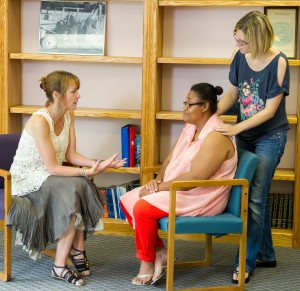 Director, Kristen Creed, counsels while another staff member offers support.
